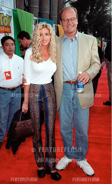 "13NOV99:  Actor KELSEY GRAMMER & wife CAMILE at the world premiere of Disney/Pixar's ""Toy Story 2"" at the El Capitan Theatre, Hollywood. He provides the voice for ""The Prospector"" character..© Paul Smith / Featureflash"
