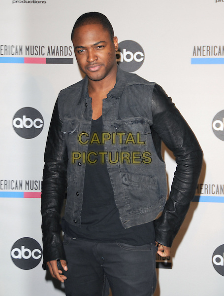 TAIO CRUZ .at The 2010 American Music Award Nomination Announcements held at The JW Marriott Los Angeles at L.A. Live in Los Angeles, California, USA, .October 12th 2010..half length black leather sleeve jacket sleeveless denim gilet shirt top  .CAP/RKE/DVS.©DVS/RockinExposures/Capital Pictures.