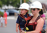 Laura St. Jacques and her son Austin, 2, wait their turn for a ride in an NV Energy bucket truck at the Touch-a-Truck event at the Carson City Library in Carson City, Nev., on Saturday, Aug. 5, 2017. <br /> Photo by Cathleen Allison/Nevada Photo Source