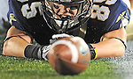 Navy's Matt Aiken loses his hold on the ball after catching it in the endzone in the last 30 seconds of the game with East Carolina, losing the game for Navy.