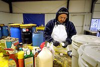 STAFF PHOTO BEN GOFF  @NWABenGoff -- 12/11/14 Victor Sandoval, hazardous waste manager, demonstrates a pH test he routinely performs on unknown materials at the Benton County Solid Waste District Household Hazardous Waste facility in Centerton on Thursday Dec. 11, 2014.