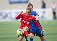 Seattle, WA - Saturday, May 14, 2016: Portland Thorns FC midfielder Meleana Shim (6) is defended by Seattle Reign FC defender Rachel Corsie (4). The Portland Thorns FC and the Seattle Reign FC played to a 1-1 tie during a regular season National Women's Soccer League (NWSL) match at Memorial Stadium.