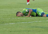 August 10, 2013: Seattle Sounders FC forward Clint Dempsey #2 lies in the grass after being fouled during an MLS regular season game between the Seattle Sounders and Toronto FC at BMO Field in Toronto, Ontario Canada.<br /> Seattle Sounders FC won 2-1.
