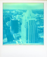 Polaroid instant picture of the Frost Bank tower and Austin, Texas Skyline shot on Impossible Cyan 600 Monochrome Instant Film - Stock Image.