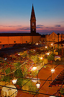 Elevated view of Hotel Baglioni restaurant and lights at dusk, Florence, Italy