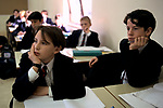 1990s School boy in classroom listening secondary school. Boys are wearing school uniform blazers Amersham Buckinghamshire 90s UK.