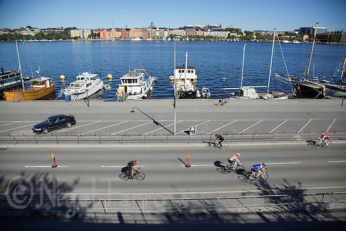 25 AUG 2013 - STOCKHOLM, SWE - Competitors cycle along the Söder Mälarstrand during the Stockholm Triathlon in Stockholm, Sweden (PHOTO COPYRIGHT © 2013 NIGEL FARROW, ALL RIGHTS RESERVED)