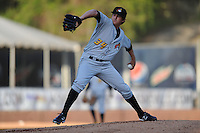 West Virginia Power starting pitcher Zack Dodson #34 delivers a pitch during a game between the West Virginia Power and the Asheville Tourists at McCormick Field, Asheville, North Carolina April 9, 2012. The Tourists won 13-5  8-4  (Tony Farlow/Four Seam Images)..