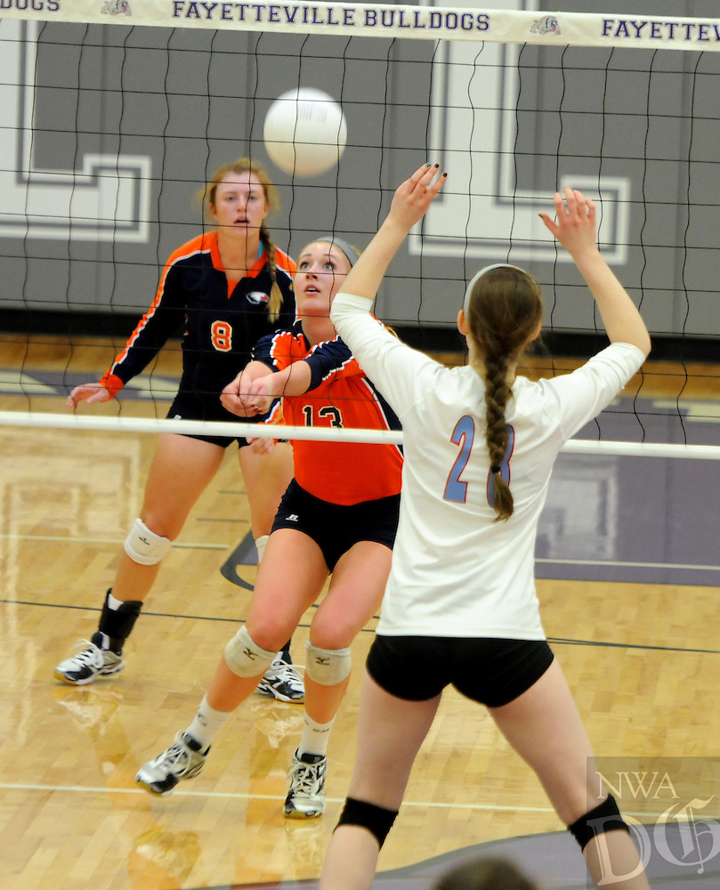 NWA Media/ J.T. Wampler -  Rogers Heritage's Elleson Dunagin sets the ball during their game against Fort Smith Southside at the 7A State Volleyball Tournament at Fayetteville Wednesday Oct. 29, 2014.