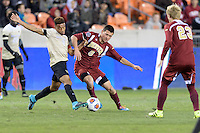 Houston, TX - Friday December 9, 2016: Sam Hamilton (8) of the Denver Pioneers battles Jacori Hayes (8) of the Wake Forest Demon Deacons for the ball in the first half  at the  NCAA Men's Soccer Semifinals at BBVA Compass Stadium.