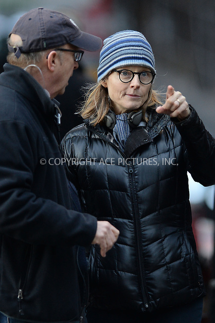 WWW.ACEPIXS.COM<br /> April 11, 2015 New York City<br /> <br /> Jodie Foster on the film set of 'Money Monster' in the Financial District of Manhattan on April 11, 2015 in New York City. <br /> <br /> Please byline: Kristin Callahan/AcePictures<br /> <br /> ACEPIXS.COM<br /> <br /> Tel: (646) 769 0430<br /> e-mail: info@acepixs.com<br /> web: http://www.acepixs.com