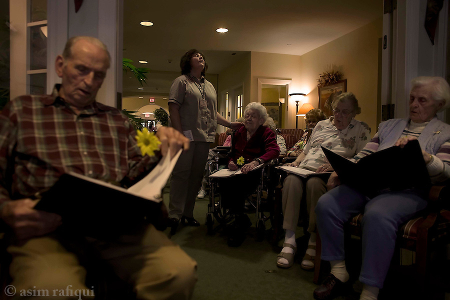 Members of Saddleback Church conduct bible study sessions at the Sunrise Assisted Living retirement home - church volunteer Peggy Ruppe works with the attendees<br />