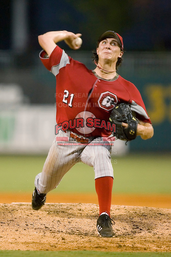Chattanooga Lookouts starting pitcher Homer Bailey winds up to deliver the ball to the plate versus the Montgomery Biscuits at Riverwalk Stadium in Montgomery, AL, Friday, August 18, 2006.
