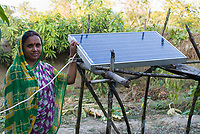 BANGLADESH , Sundarbans, village Burigoalinoi , micro-finance bank Grameen Shakti and NGO Srizony , promote micro-credit financed Solar Home Systems in villages, woman with PV panel