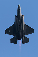 Underside of a United States Air Force Lockheed Martin F-35 Lightning II fifth generation fighter in afterburner.