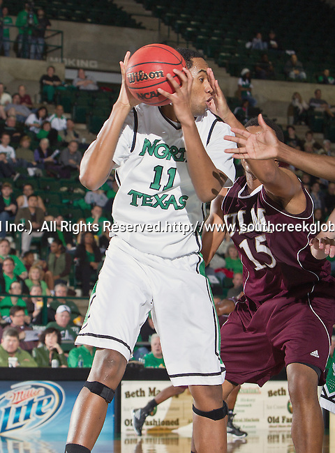 North Texas Mean Green forward Forrest Robinson (11) in action during the game between the Louisiana Monroe Warhawks and the University of North Texas Mean Green at the North Texas Coliseum,the Super Pit, in Denton, Texas. UNT defeats ULM 86 to 51...