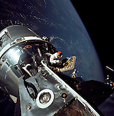"""In Earth Orbit - (FILE) -- The docked Apollo 9 command and service modules and lunar module conduct the first docking maneuvers in space. This image was taken on March 6, 1969, the fourth day of the Apollo 9 Earth-orbital mission by lunar module pilot Russell L. Schweickart of David Scott, command module pilot, in the open hatch of the command module.  This photo is part of the book """"Apollo: Through the Eyes of the Astronauts"""" published to commemorate the 40th anniversary of the first manned lunar landing on July 20, 1969. .Credit: NASA via CNP"""