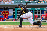 Indianapolis Indians outfielder Pablo Reyes (12) swings at a pitch during an International League game against the Buffalo Bisons on July 28, 2018 at Victory Field in Indianapolis, Indiana. Indianapolis defeated Buffalo 6-4. (Brad Krause/Four Seam Images)
