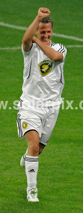 **ALL ROUND PICTURES FROM SOLARPIX.COM**.**SYNDICATION RIGHTS FOR UK AND SPAIN ONLY**.The German Former Formula 1 driver Michael Schumacher at the charity football cup Goal 4 Africa at the Allianz Arena in Munich ( Muenchen ) in Germany...JOB REF:6816-CPR/Philipp Guelland  DATE:12_07_08.**MUST CREDIT SOLARPIX.COM OR DOUBLE FEE WILL BE CHARGED* *UNDER NO CIRCUMSTANCES IS THIS IMAGE TO BE REPRODUCED FOR ANY ONLINE EDITION WITHOUT PRIOR PERMISSION*