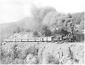 D&amp;RGW #476 K-28 with baggage car and 6 coaches on the High Line out of Rockwood.<br /> D&amp;RGW  High Line, MP 468.7, CO  Taken by Payne, Andy M. - 8/21/1952