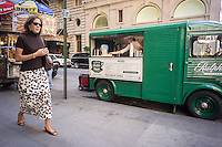 The Ralph's Coffee truck, a converted 1965 Citroën truck is parked outside the brand new Polo Ralph Lauren store of Fifth Avenue in New York on Friday, September 12, 2014. Besides being a flagship store on a premiere shopping street Lauren is following the lead of numerous other retailers and has a coffee shop inside the store, as well as the truck promotion. The cafe and truck sell Ralph's Coffee with the custom blend of beans personally chosen by coffee aficionado Lauren.  (© Richard B. Levine)