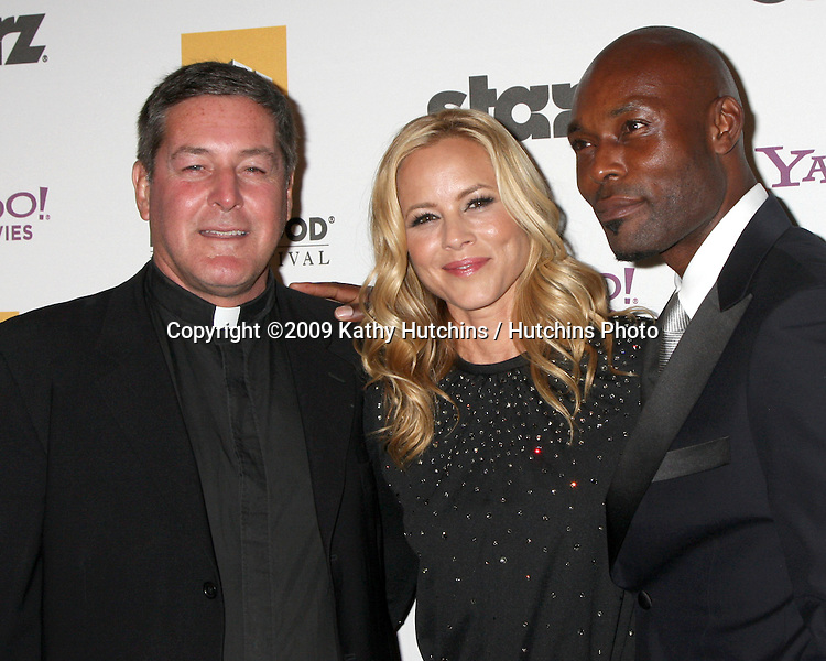 Father Rick Frechette, Maria Bello, Jimmy Jean-Louis.arriving at the 13th Annuall Hollywood Film Festival Awards Gala Ceremony.Beverly Hilton Hotel.Beverly Hills,  CA.October 26, 2009.©2009 Kathy Hutchins / Hutchins Photo.