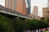 Each summer night the world's largest urban bat colony emerge from under the Ann W. Richards Congress Avenue Bridge on Lake Austin, Texas.