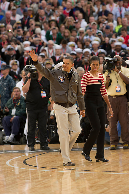 SAN DIEGO, CA - NOVEMBER 11, 2011: (L to R) First Lady of the United States Michelle Obama and Barack Obama the 44th President of the United States in action during the Opening Ceremonies of the 2011 Quicken Loans Carrier Classic on the USS Carl Vinson prior to a game between the Michigan State Spartans and the North Carolina Tar Heels..(Photo by Robert Beck / ESPN)..- RAW FILE AVAILABLE -.- CMI000165177.jpg -