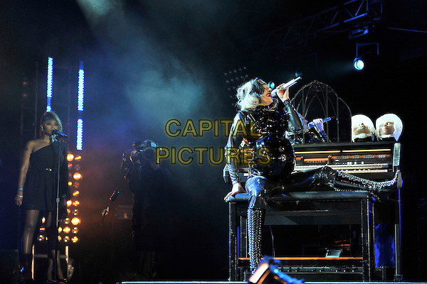 LADY GAGA (Stefani Joanne Angelina Germanotta).Performing live at Radio 1's Big Weekend, Carlisle, England, UK..May 15th 2011.stage concert live gig performance music full length pvc shiny leather side pregnant bump headband grey gray trousers jacket singing sitting piano nun nuns heads decapitated .CAP/MAR.© Martin Harris/Capital Pictures.