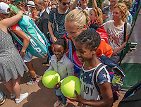Paris, France, 22 June, 2016, Tennis, Roland Garros, Kiki Bertens (NED) posing with fans after her match<br /> Photo: Henk Koster/tennisimages.com