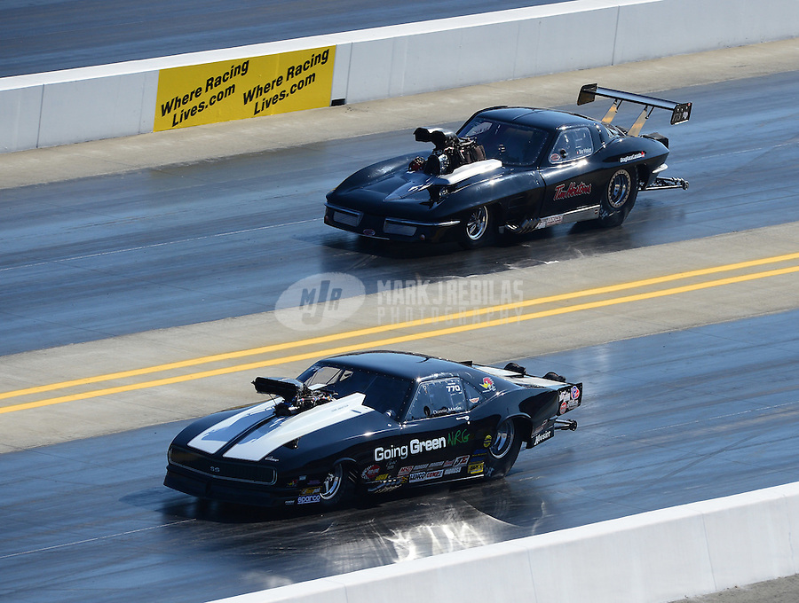 Apr. 14, 2012; Concord, NC, USA: NHRA pro mod driver Donnie Martin (near lane) races alongside Ike Maier during qualifying for the Four Wide Nationals at zMax Dragway. Mandatory Credit: Mark J. Rebilas-
