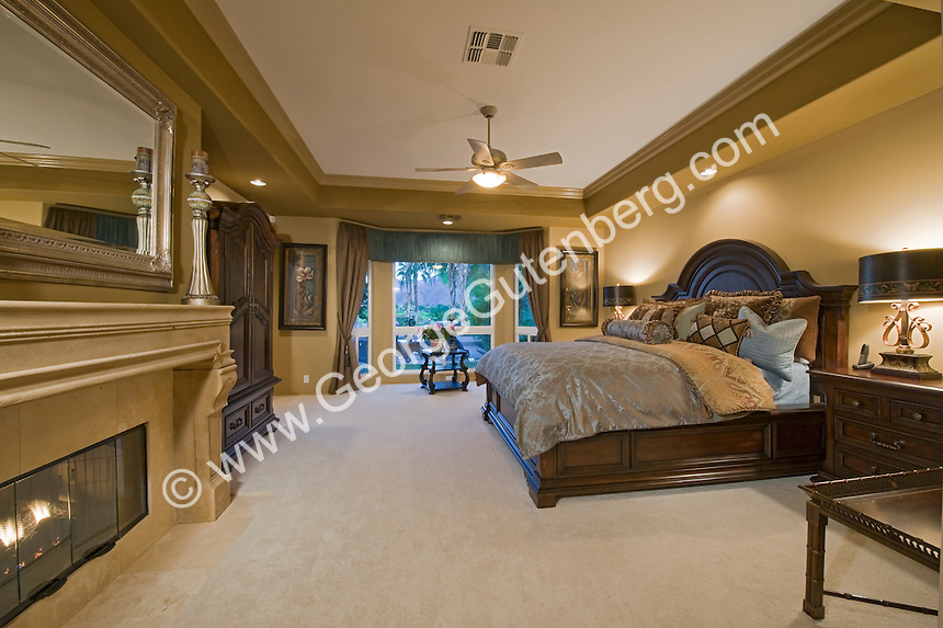 Luxury Master Suite With Fireplace stock photo of residential bedroom interior design stock photo of