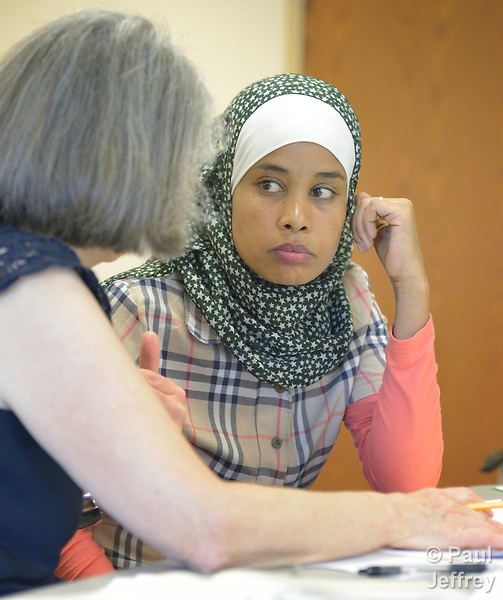 Hayat Husen, a newly arrived refugee, is tutored by Shirley Kurtz in a cultural orientation class in a United Methodist Church in Harrisonburg, Virginia. Husen was resettled in the Harrisonburg area by Church World Service, which also sponsors the class.<br /> <br /> Photo by Paul Jeffrey for Church World Service.