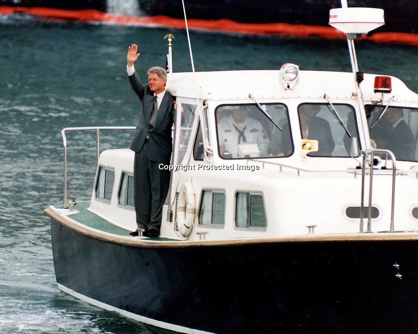 U.S. President Bill Clinton waves to the crowd on the dock of the Alameda Naval Air Station, Alameda, Ca as .he arrives by Coast Guard boat. 1993, (photo by Ron Riesterer)