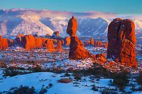 Balanced Rock in winter,  Arches National Park, Utah, La Sal Mountains beyond, Sunset