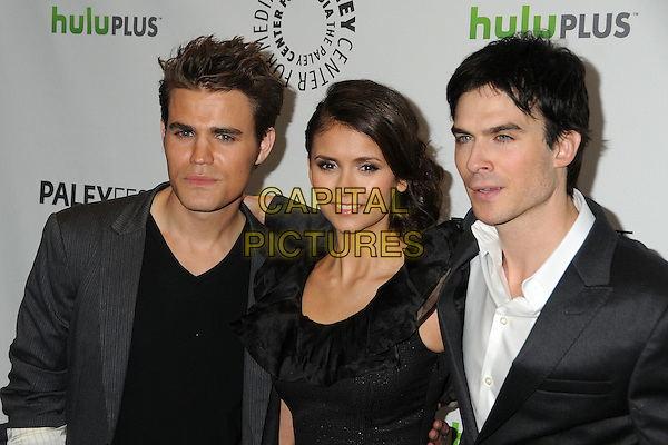 "Paul Wesley, Nina Dobrev, Ian Somerhalder.PaleyFest 2012 Presents ""The Vampire Diaries"" held at the Saban Theatre. Beverly Hills, California, USA, .10th March 2012.half length black dress grey gray suit jacket white shirt cast.CAP/ADM/BP.©Byron Purvis/AdMedia/Capital Pictures."
