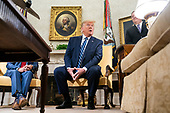 US President Donald J. Trump (R) meets with Canadian Prime Minister Justin Trudeau (not pictured) in the Oval Office of the White House in Washington, DC, USA, 20 June 2019. The president spoke to the media about Iran shooting down an American drone, saying it might not have been intentional.<br /> Credit: Jim LoScalzo / Pool via CNP