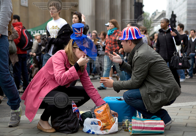 People eat a picnic while celebrating in Trafalgar Square, London during the Royal Wedding between Britain's Prince William and Kate Middleton..