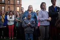 People gather outside Cambridge City Hall in Cambridge, Mass., on April 18, 2013, for a candlelight vigil and prayer two days after the Boston Marathon bombings.  The vigil was hosted by the City of Cambridge and the Cambridge Black Pastors' Association.