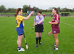 Referee Liz Dempsey with Clare captain Emma Kennedy and Galway captain Leanne Helebert before the Minor A All-Ireland final against Clare at Nenagh.  Photograph by John Kelly.
