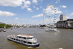 London - Great Britain / United Kingdom - 28 June 2008---London Eye, the big observation (Ferris) wheel, and sightseeing boats with tourists on River Thames---tourism, architecture, transport---Photo: Horst Wagner / eup-images