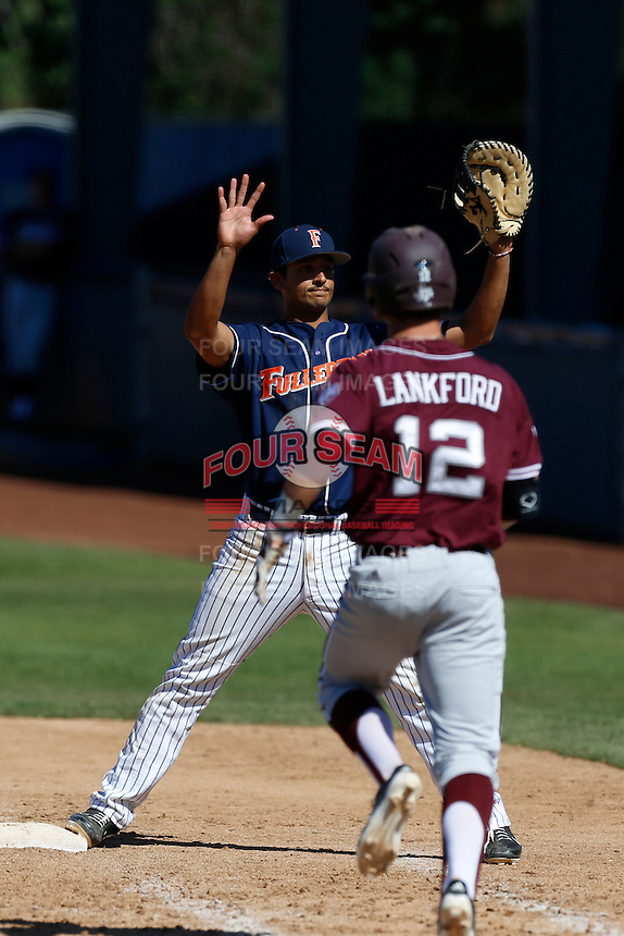 of the Cal State Fullerton Titans during a baseball game against the Texas A&M Aggies at Jackie Robinson Stadium on March 9, 2013 in Los Angeles, California. (Larry Goren/Four Seam Images)