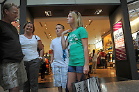 (L-R) Brian Jensen, 49, Beth Jensen, 47, Brandon Jensen, 10, and Taylor Jensen, 12, of Bloomington, Illinois go back to school shopping at the Woodfield Mall in Schaumburg, Illlinois on September 5, 2010. The Jensens said they planned to spend between $400 and $500 on back to school clothes and accessories this fall.