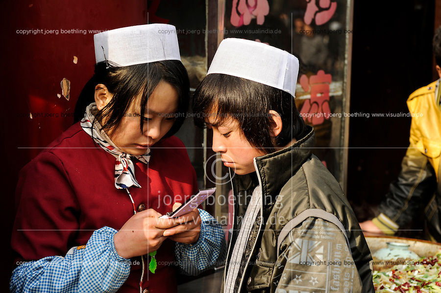 CHINA, Province Shaanxi, city Xian, chinese muslim Hui, boy and girl with mobile phone