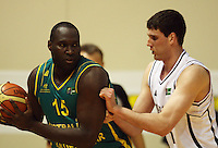 Boomers forward Nathan Jawai looks to get by Tall Blacks centre Alex Pledger during the International basketball match between the NZ Tall Blacks and Australian Boomers at TSB Bank Arena, Wellington, New Zealand on 25 August 2009. Photo: Dave Lintott / lintottphoto.co.nz
