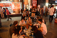 People gather for Iftar dinner on newspapers on Istiklal Street in a show of solidarity with the demonstrators that had previously occupied Gezi Park at the start of Ramadan in Istanbul, Turkey on July 9, 2013.  Since demonstrators occupied Gezi Park for two and a half weeks last month, police have maintained a heavy presence in Taksim Square and periodic clashes have erupted as demonstrators have returned to the square in protest of Prime Minister Recep Tayyip Erdogan.