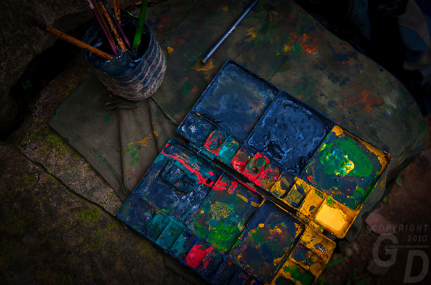 Local Khmer artists working at the many ruins and temple complexes, producing paintings of the accent Khmer temples. This is a worn out Paint Palette from one of the artists at the nearby Ruins of Angkor Wat.