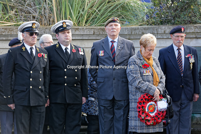 Pictured: Former members of the Armed Forces joined with locals during the service. Sunday 11 November 2018<br /> Re: Commemoration for the 100 years since the end of the First World War on Remembrance Day at the Swansea Cenotaph in south Wales, UK.