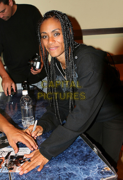 JADA PINKETT SMITH.Signs autographs after her band, Wicked Wisdom opened the show for Alice Cooper at The Grove of Anaheim in Anaheim, California, USA, August 15, 2006..half length dreadlocks hair rock band music backstage concert.Ref: DVS.www.capitalpictures.com.sales@capitalpictures.com.©Debbie VanStory/Capital Pictures