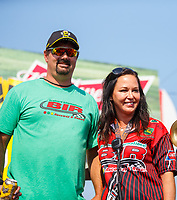Aug 20, 2017; Brainerd, MN, USA; Brainerd International Raceway track owner Jed Copham (left) with wife Kristi Copham during the NHRA Lucas Oil Nationals. Mandatory Credit: Mark J. Rebilas-USA TODAY Sports